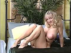Big titted cock tease Danni Ashe plays with her breasts on her bed