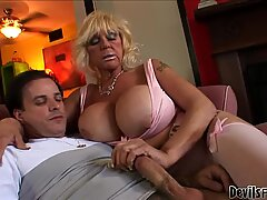 Busty granny stokes and sucks a big beefy cock