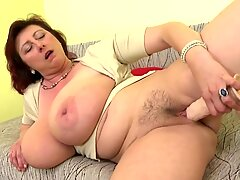 Mature queen mommy with giant tits and hungry cooch